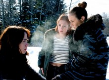 "WYNONNA EARP -- ""Everybody Knows"" Episode 207 -- Pictured: (l-r) Melanie Scrofano as Wynonna Earp, Katherine Barrell as Officer Nicole Haught, Dominique Provost-Chalkley as Waverly Earp -- (Photo by: Michelle Faye/Wynonna Earp Season 2, Inc./Syfy)"